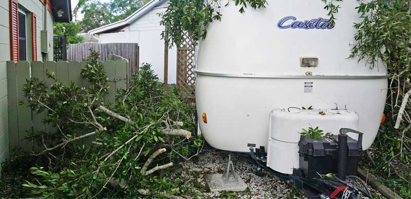 Our small travel trailer, surrounded by debris after Hurricane Irma