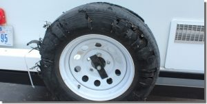 Blown out Small Travel Trailer Tire