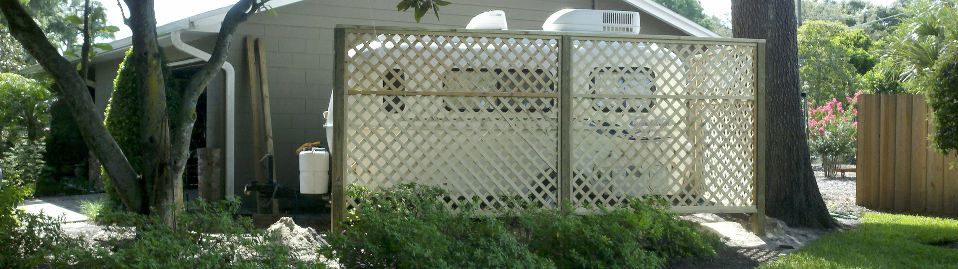 Small travel trailer stored at home