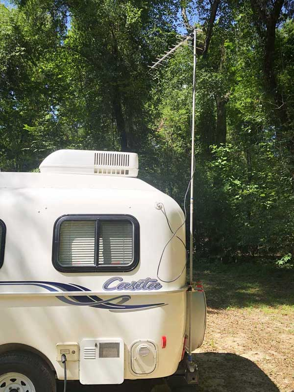 The TV antenna all set up on our small travel trailer